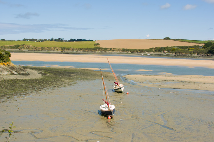 Boats on a creek in the Camel Estuary near St issey in Cornwall